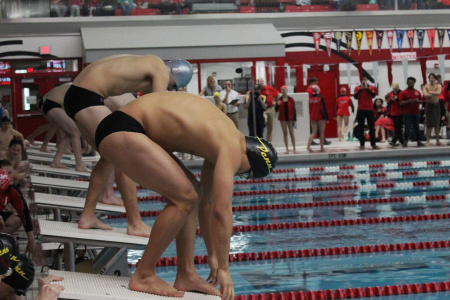 The+boys+swimmers+line+up+at+the+blocks.+They+were+ready+to+compete+in+the+400+medley.