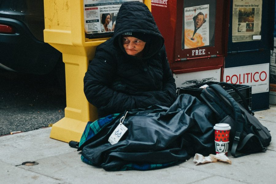 A+homeless+woman+sits+on+the+ground+in+D.C.+She+greeted+and+encouraged+students+to+enjoy+the+city+as+they+walked+by+on+the+way+to+the+monuments.+Photo+by%3A+John+Sanchez