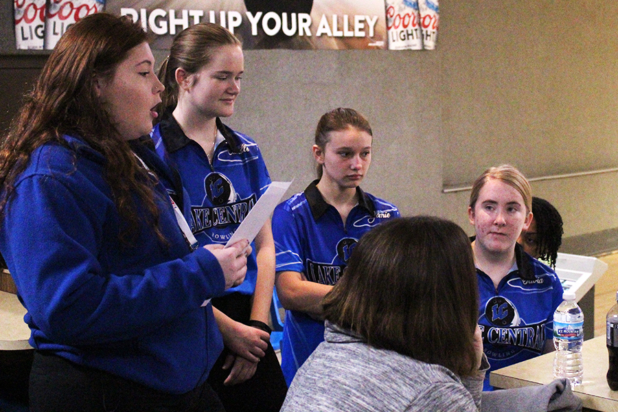 The team goes over the player order before the tournament begins. The girls were hopeful for a great end to the season.