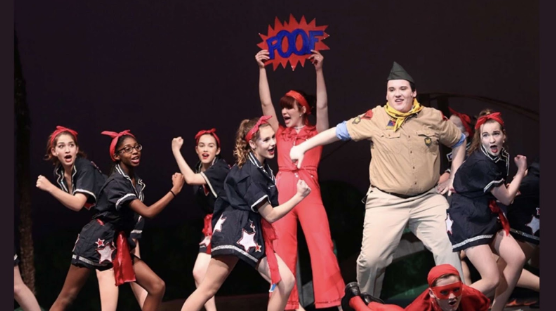 Cassandra Morgan (11) performs on stage with other members of theater. Lake Central Theater does multiple shows throughout the year.