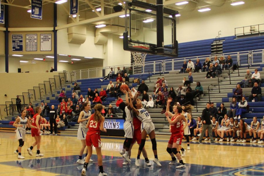 Deana Muha (9) and Aneisah Gail (9) fight for the rebound. They jumped to get the ball from Crown Point.