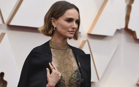 Natalie Portman poses on the red carpet at the 2020 Academy Awards on Sunday, Feb. 9. Portman's dress included the names of snubbed female directors stitched onto it in gold thread.