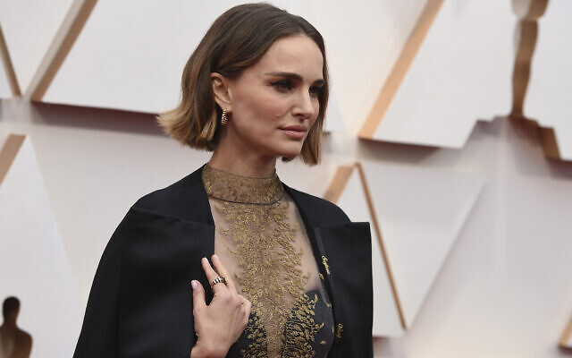 Natalie+Portman+poses+on+the+red+carpet+at+the+2020+Academy+Awards+on+Sunday%2C+Feb.+9.+Portman%E2%80%99s+dress+included+the+names+of+snubbed+female+directors+stitched+onto+it+in+gold+thread.