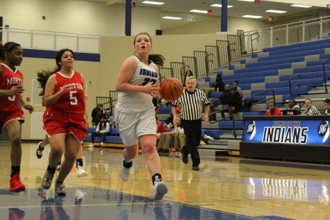 Addison Graf (9) runs the ball down to LC's side of the court.  The ball was passed to one of Graf's teammates.