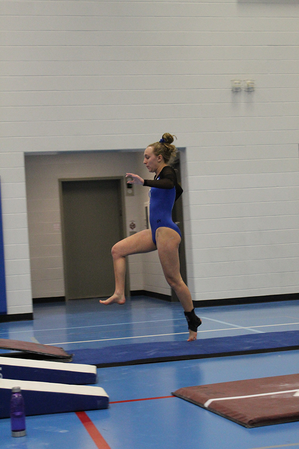 Nicole+Wasyliw+%2811%29+gets+ready+to+compete+in+her+vault+event.+Wasyliw+pulled+through+by+sticking+her+landing+and+impressing+the+judges.+%0A