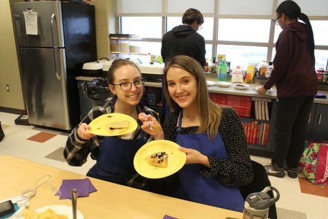 Claire Bandstra (12) and Allison Centanni (12) pose with their finished crepes. The girls were the first to finish making the desserts.