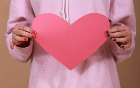 Brenna Polovina (10) holds up a cut-out heart. Valentine's Day is celebrated yearly on Feb. 14.