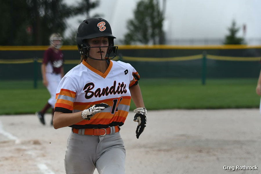 Sydney Doloszycki (10) sprints to the base. She played for Varsity and a travel softball team. Photo submitted by: Sydney Doloszycki (10)