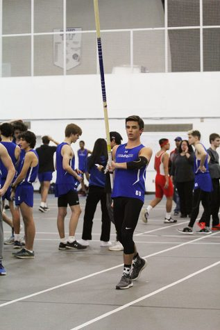 Doug Belcaster (12) prepares for his next attempt on pole vaulting. Belcaster passed multiple heights during the meet.