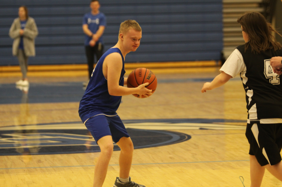 Cole Thompson (10) gets ready to pass the ball to his teammate so he can shoot. The two working together were able to score points for the team, putting them in the lead against Lowell.