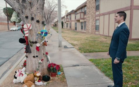 Prosecutor, Jonathon Hatami, stands at the memorial created for Gabriel Fernandez.  The memorial was created by people all over Los Angeles after Gabriel's death.