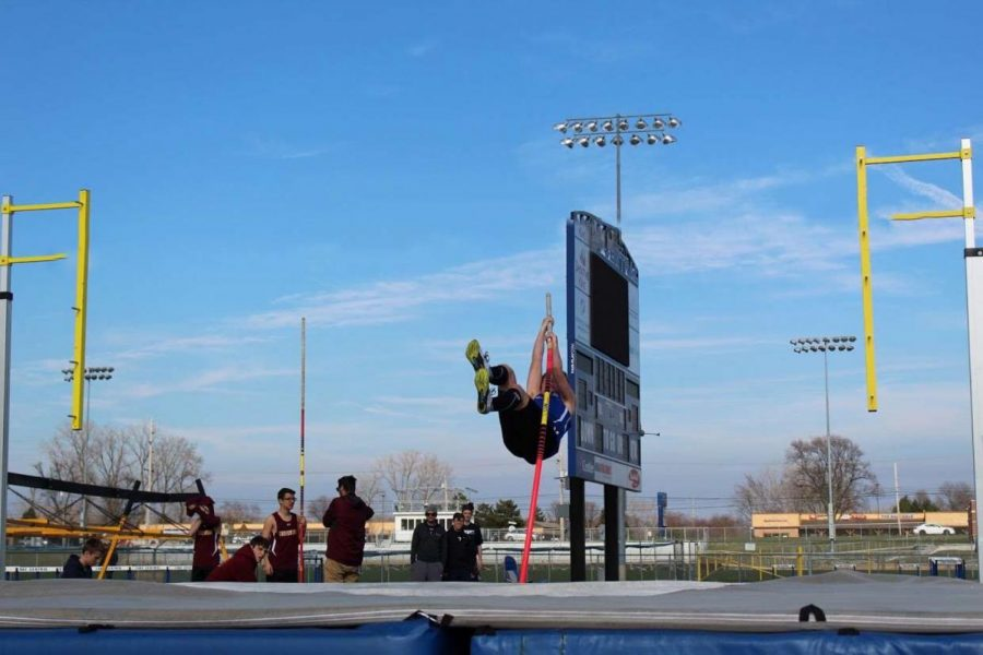 Aidan O'Neill (12)  practices pole vaulting before his meet against Chesterton. O'Neill's best jump was 11 feet 6 inches.