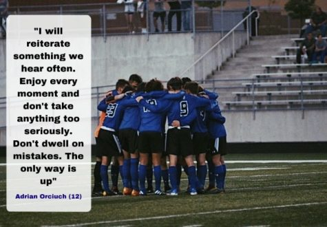 The soccer team huddles up to discuss the game and encourage one another. The soccer team was a close knit team this year.