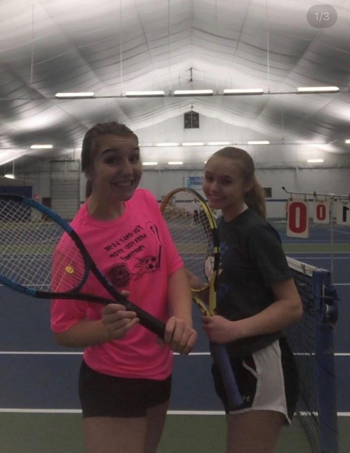 Maya Gorney (9) and Maya Trivunovic (9) smile as they hold their tennis rackets.  They both met up at Matchpoint Tennis and Fitness Club to practice before the high school season was supposed to start.