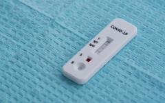 This test involves taking a small amount of blood and tells someone if they have had the virus before. The viral test takes a swab from the inside of their nose and tells if they have the virus currently.
