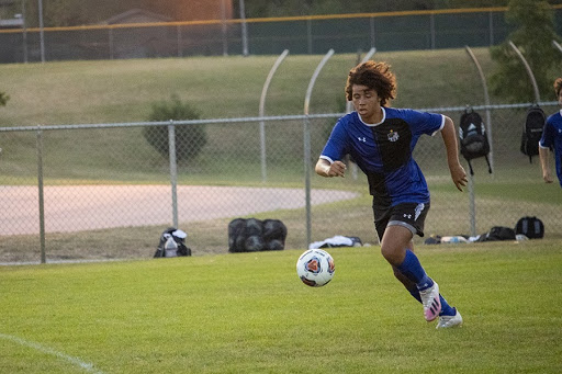 Tre Adams (11) takes the ball toward the goal.  The team was focused and had extremely high energy the entire night.
