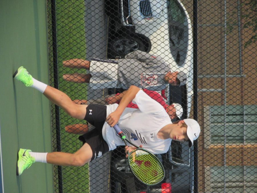 Matthew Wlodarczyk (9) competes during his second set as spectators watch from outside the courts. He won his matches 2-0.