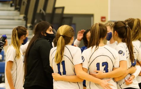The team all joins together after a timeout. The group worked well together to defeat Chesterton.