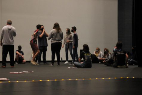 The theatre company playing a warm up game. This year's show will consist of 26 monologues.