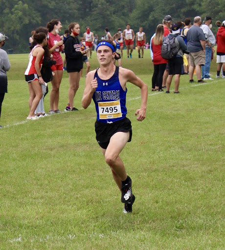 Logan Russell (12) runs at the Bob Thomas invite. Logan passed up two people on his way to the finish.