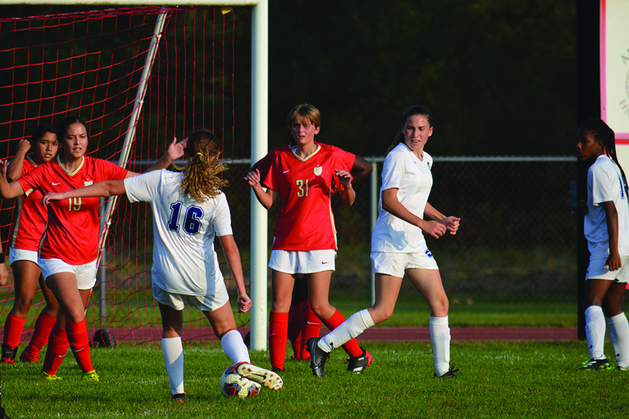 Sydney Petrovich (9) strikes the ball into the goal. She was surrounded by many Andrean defenders.