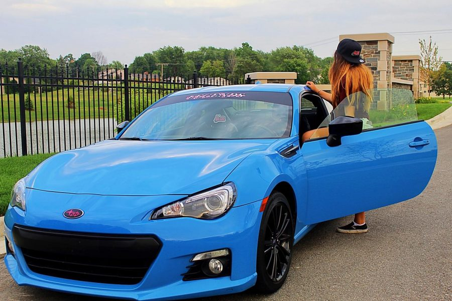 Asia Garcia shows off her new BRZ series HyperBlue along with her multiple add-ons and decals. With the extra equipment bought and used, Garcia's car reflects the many years she spent watching and studying cars.