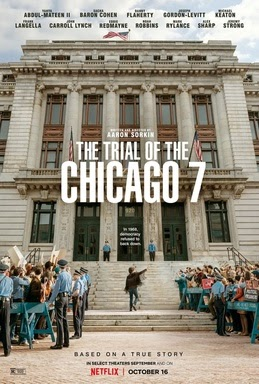 This is the movie poster for The Trial of The Chicago 7. It shows Abbot Hoffman standing in front of a court of law, protesters and police on both sides of him, this poster can depict what is to come in the story.