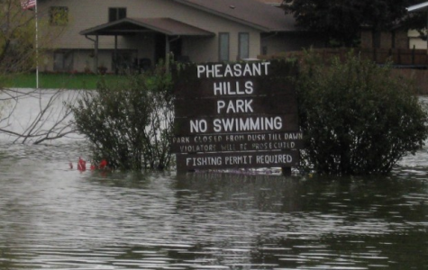 Floods cover the field by Pheasant Hills Park. There have been floods in the past few years in our region.