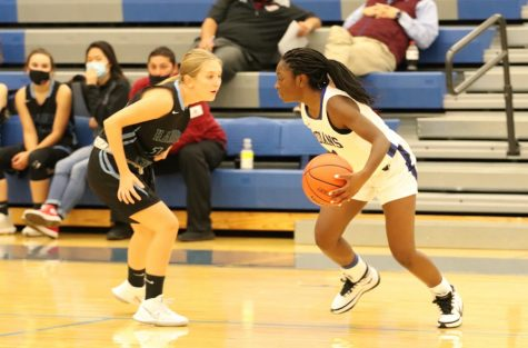 Aneisah Gail (11) attempts to bring the ball around the court while dodging a player from Hanover Central.  She helped the team secure the win and bring home the champion title.