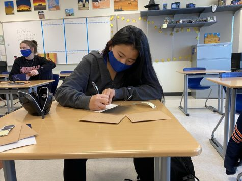 Kimberly Hesterman (11) focuses on putting detail into her card. As president of the Junior Class Cabinet she wanted to make teacher appreciation run as smoothly as possible.