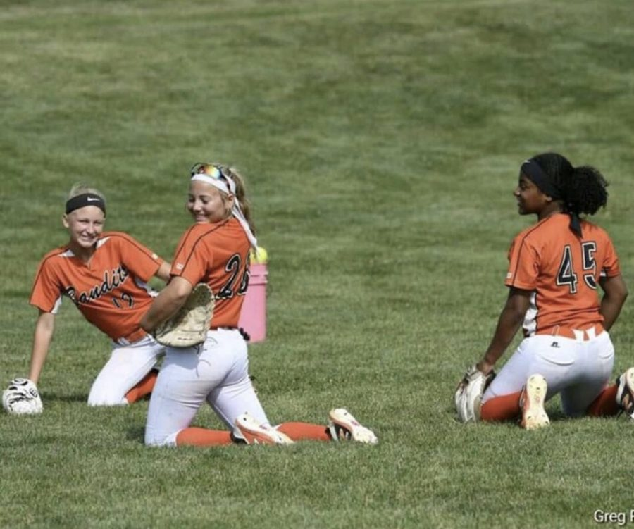 Amanda Aardema (11) poses for the camera with her teammates from her travel ball  team, The Beverly Bandits. She had been a part of the team for around four years now.