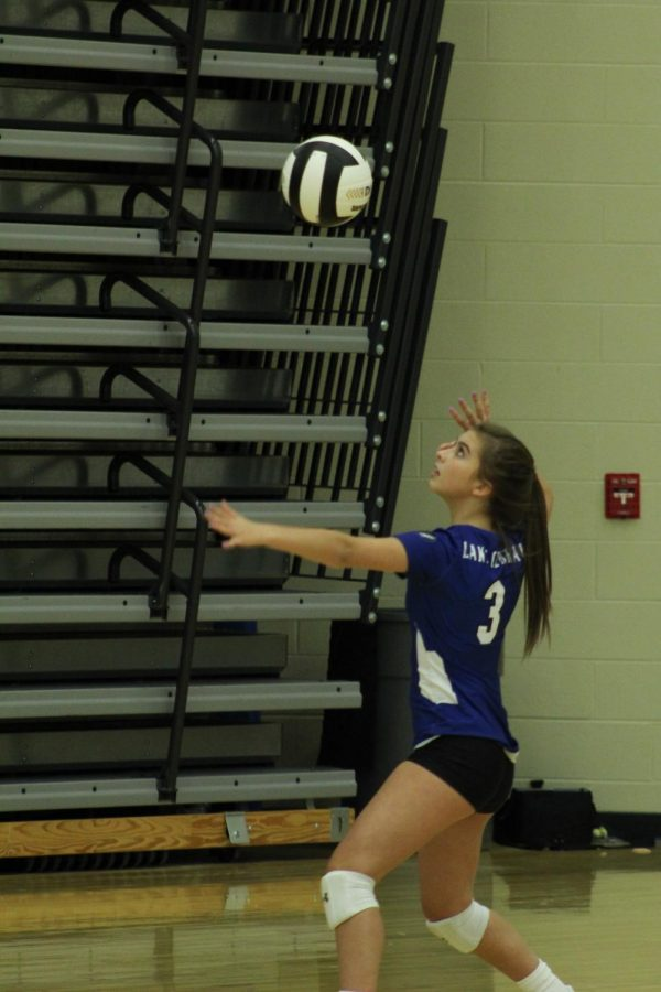 Rachel Hernandez (10) lines herself up to serve the ball.  Lowell received the serve and started the volley.