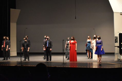 The Varsity choir singing. They were second in the program and contrasted with the other choirs by wearing all black.