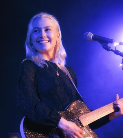 "Phoebe Bridgers performs at the Crocodile Café in Seattle, Washington in 2018. Bridgers quickly gained traction in the music industry, which was further proliferated by her Grammy-nominated album ""Punisher"" in 2020.   Photo by David Lee from Redmond, WA, USA, CC BY-SA 2.0 , via Wikimedia Commons"