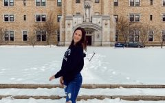 Grace Renschen (12) poses in front of St. Mary's College.  She recently committed to play softball at St. Mary's.