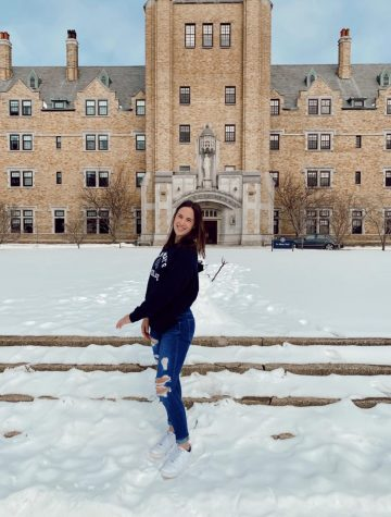Grace Renschen (12) poses in front of St. Mary