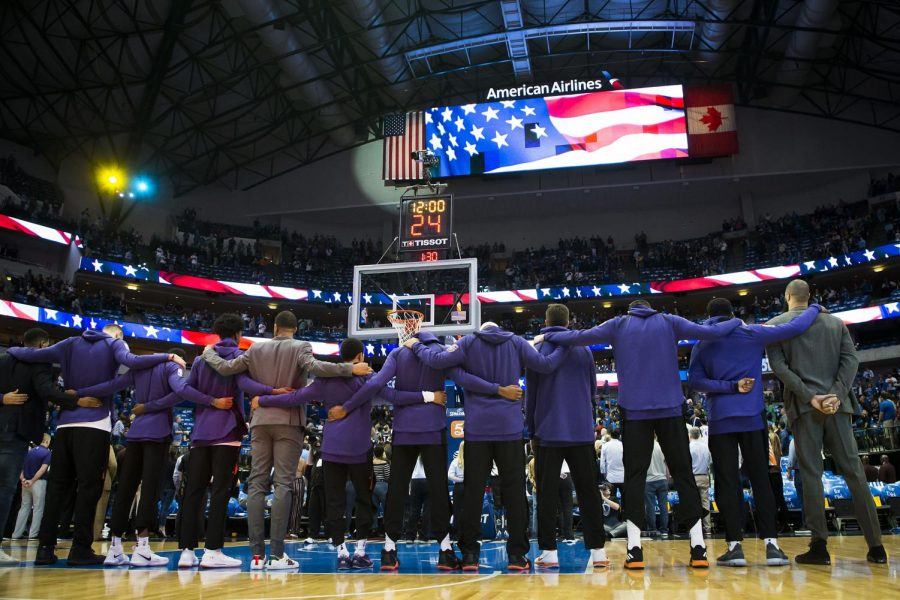 Phoenix Suns players lock arms for the national anthem before the season finale against the Dallas Mavericks on Tuesday, April 10, 2018 at American Airlines Center in Dallas, Texas. (Smiley N. Pool/Dallas Morning News/TNS)