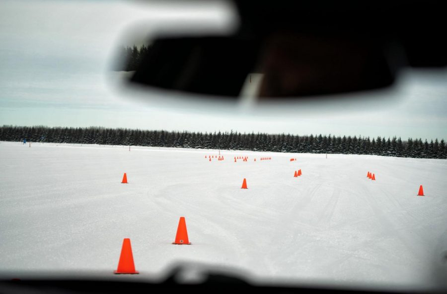 Driving Instructor Greg Vandersluis tests drives a vehicle in Baudette, Minn. He travels through snow on the test facility.