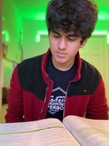 Aneesh Poddutur (12) prepares for an AP Statistics test. Poddutur reflected on his experiences, efforts and accomplishments after being named a National Merit Scholarship Finalist along with Claire Lavoie (12).