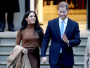 Prince Harry and wife Meghan Markle smiled at the paparazzi. The two were walking hand in hand.