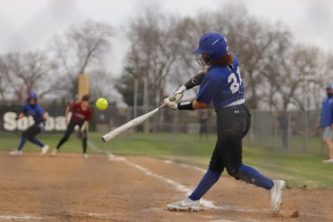 Bree Mitchell (11) swings at a pitch and puts it to right field. The hit went over the right fielder