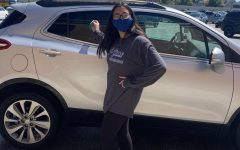 Madison Naranjo stands by a car ready to clean it. She was one of the estimated 50 students in attendance on Wednesday.