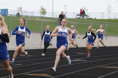 Emily Thomas (12) and others get off to a quick start for the 800m race.  Abby Martisek placed first in this event.