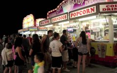 People stand in line at the Dyer summer fest for food.  They were served nachos, popcorn and hotdogs.
