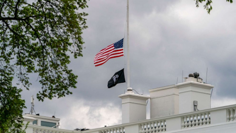 The American flag above the White House flies at half-mast April 16, 2021. (Andrew Harnik/AP)