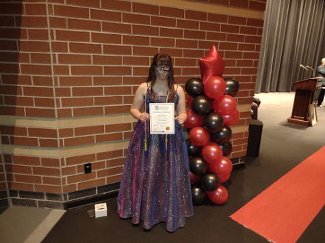 Allison Peterson (12) receives her thespian cords for graduation. Theatre had been an outlet for her to express her creativity and make new friends throughout her years in high school.