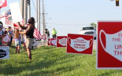Navigation to Story: Students and parents organize Unmask the Kids protest along U.S. Route 41