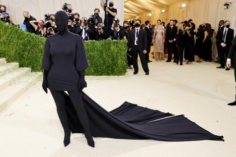 Kim Kardashian steps onto the Met steps in a black Balenciaga look. While she did not confirm it was her, the long black ponytail and similar looks prior to the gala gave her away.