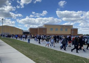 Students walk to buses parked on US 41. Students taking buses were released before student drivers at 2:10 p.m. Photo submitted by: Kedric Meredith, parent of student.