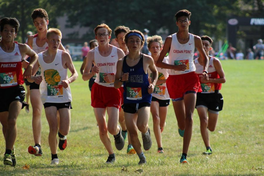 Sebastian Groszek (10) passes ahead of several other runners. He finished with a time of 19:43.